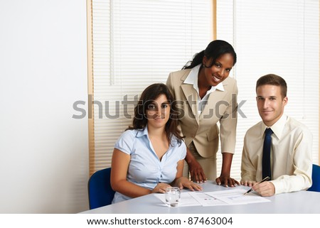 Multinational group of young business people looking at the camera. - stock photo
