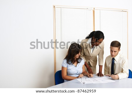 Multinational group of young business people working with documents. - stock photo