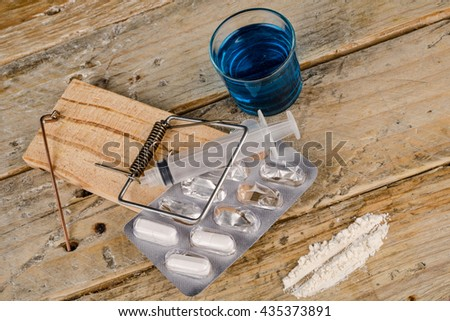 Multiple addictions represented with a mousetrap, a concept - stock photo