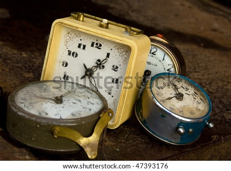 Multiple alarms on rusty background - stock photo