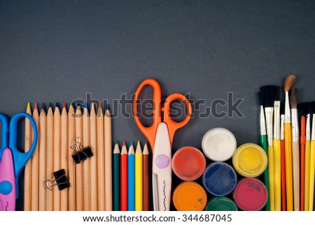 Multiple art tools set in a row on a gray background.