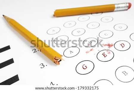 Multiple choice exam with GED text. Remedial high school concept                                - stock photo