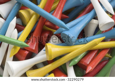 Multiple colored golf tees. Background - stock photo