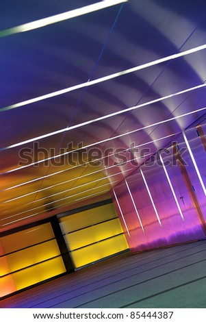 multiple colored subway corridor with neon lights - stock photo