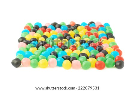 Multiple colorful candy ball sweets forming a square shape, composition isolated over the white background, side view foreshortening with a shallow depth of field - stock photo