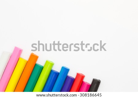 Multiple colors clay sticks on white background