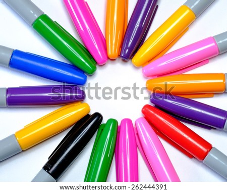 Multiple coloured markers in a circle - stock photo