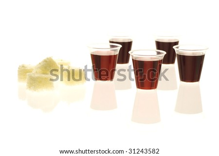 Multiple communion cups with wine and bread - stock photo