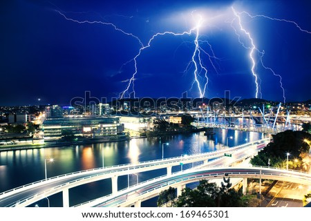 Multiple electric lightning strikes over river in Brisbane, Queensland, Australia - stock photo