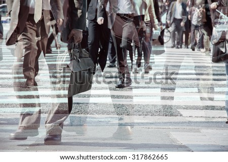 Multiple exposure image of businessman walking - stock photo