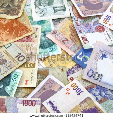 Multiple foreign currency and money with denomination of each note visible.