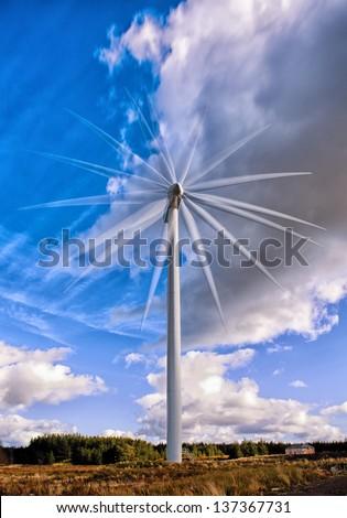 Multiple frame exposure of a wind turbine in Scotland - stock photo