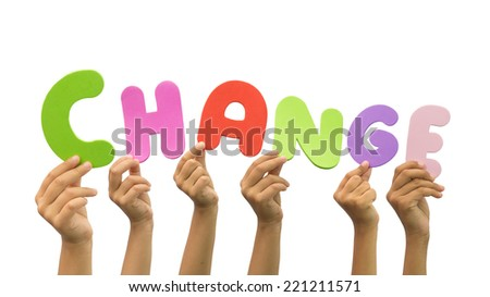 Multiple hands holding the word change - stock photo