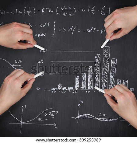 Multiple hands writing with chalk against blackboard - stock photo