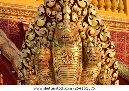 Multiple headed serpent decorating the railings or bannisters of buddhist temple - stock photo