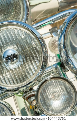 multiple headlight assembly on a 1960's retro Italian motorcycle scooter - stock photo