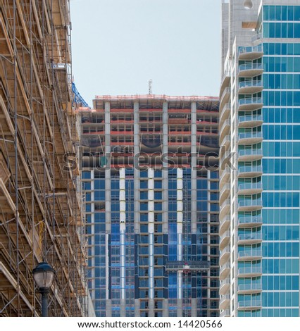 Multiple highrise buildings under construction in Atlanta, Georgia, in varying stages of completion. - stock photo