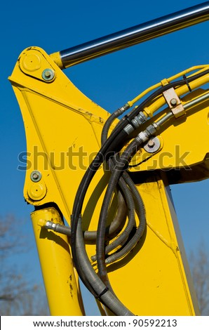 Multiple Hydraulic Hoses on a Yellow Excavator