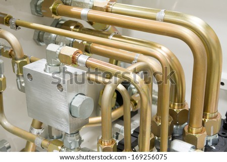 Multiple Hydraulic Tubes and Fittings on Hydraulic Equipment - stock photo