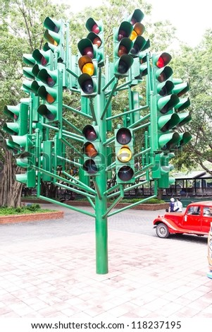 Multiple large traffic lights post made from green metal, taken on a cloudy day - stock photo