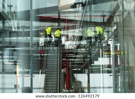 Multiple layers and reflection of a modern airport building with airport workers