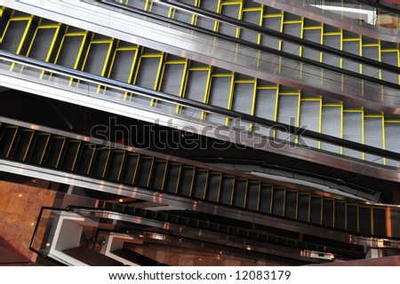 Multiple layers of escalators in a shopping center.