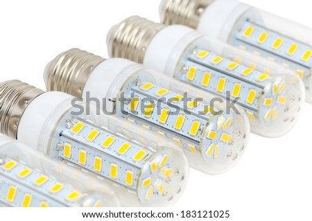 Multiple LED bulbs corn lying side by side on a white background - stock photo