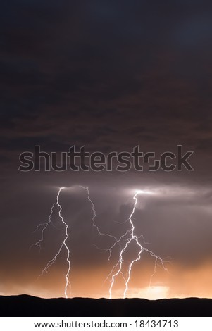 Multiple Lightning Strikes at Dusk - stock photo