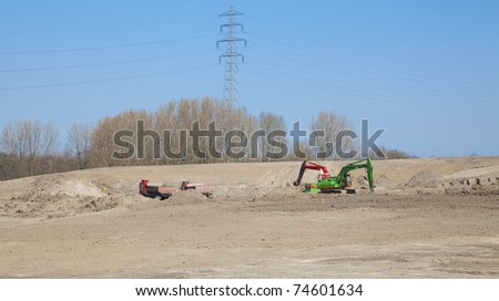 Multiple machines are digging sand - stock photo