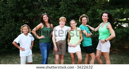 Multiple members of a large family group representing 3 generations - stock photo