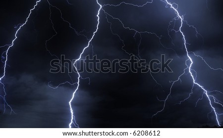 multiple powerful lightning strikes at night - stock photo