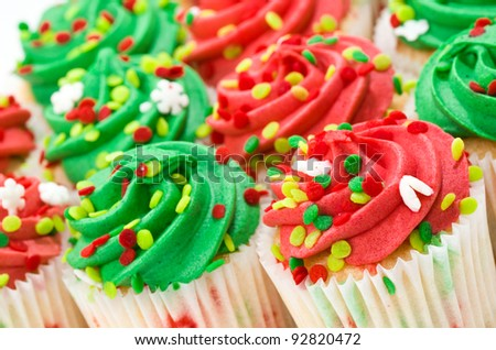 Multiple Red and Green Cupcakes with Sprinkles - stock photo