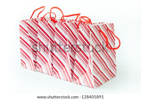 Multiple red stripe gift bags isolated on white background - stock photo