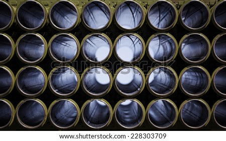 Multiple rocket launcher system, empty shafts. War concept. Shallow depth of field. - stock photo