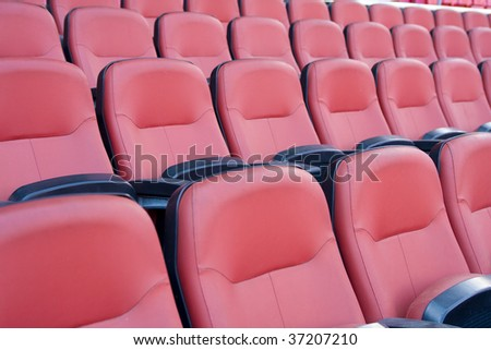 Multiple seats in row on football stadium. - stock photo