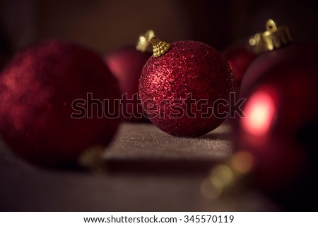 Multiple shiny red Christmas tree decoration balls - stock photo