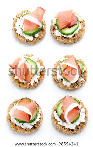 Multiple smoked meat starters on a white platter - stock photo