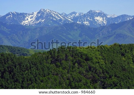 Multiple snow-capped mountain ranges stretching off into the distance near Salt Lake City, Utah. - stock photo