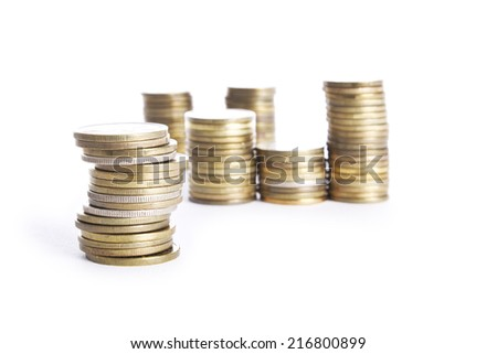 Multiple stacks of  coins on white background - stock photo