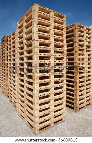 multiple stacks of wooden pallets - stock photo