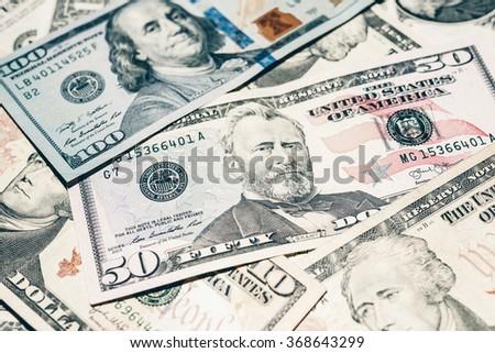 Multiple US dollars. Background of dollars. - stock photo
