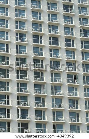 multiple window pattern on hotel facade - stock photo