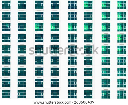 Multiple windows on a large office building - stock photo