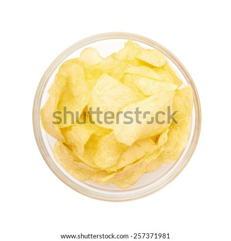 Multiple yellow potato chips snacks in a glass bowl, composition isolated over the white background, top view above foreshortening - stock photo