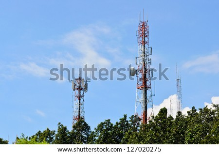 Multiplicity communications tower on the hill, beautiful sky background - stock photo