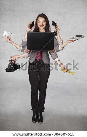 multipurpose business woman on the grey background - stock photo