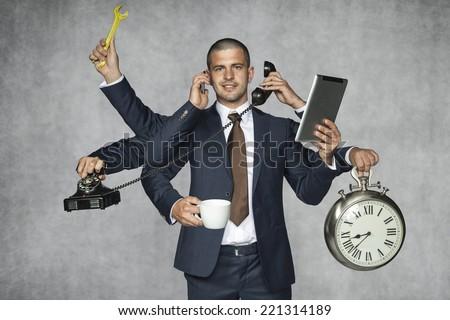 multipurpose businessman - stock photo