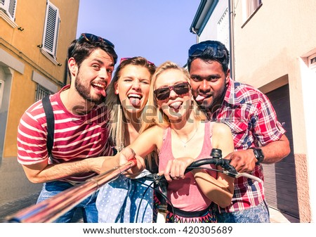 Multiracial best friends selfie photo and fun on summer vacation - Multiethnic happy group self photo with tongue out in old town tour - Teenagers students joyful moments using mobile phone technology - stock photo