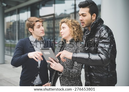 Multiracial business people working outdoor in town connected with technological devices