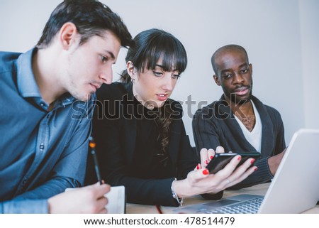 Multiracial business people working together connected with technological devices like smart phone handhold - teamwork, business, working concept